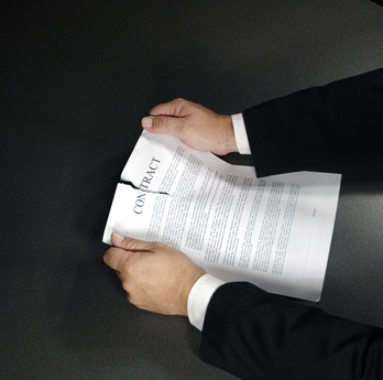 A contract being ripped up